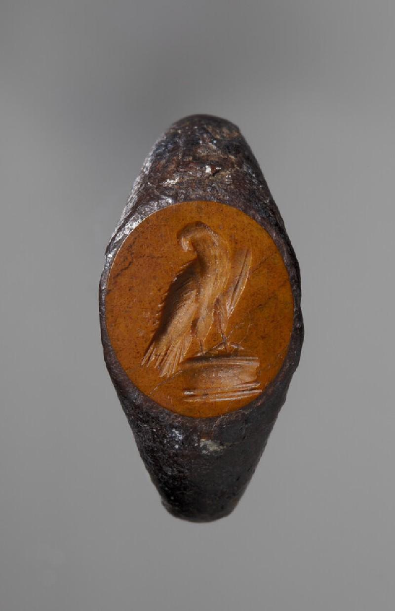 Intaglio gem set in an iron ring, eagle perching on an altar (ANFortnum.FR.163)