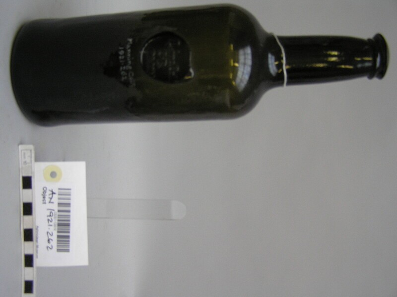 Glass wine bottle with stamp of Lincoln College Common Room (AN1921.262, record shot)