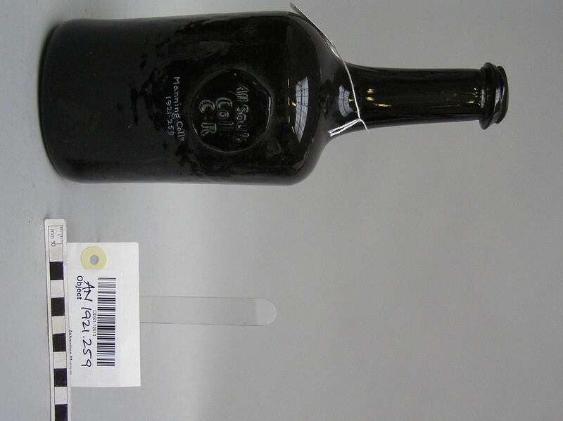 Glass wine bottle with stamp of All Souls College Common Room (AN1921.260, record shot)