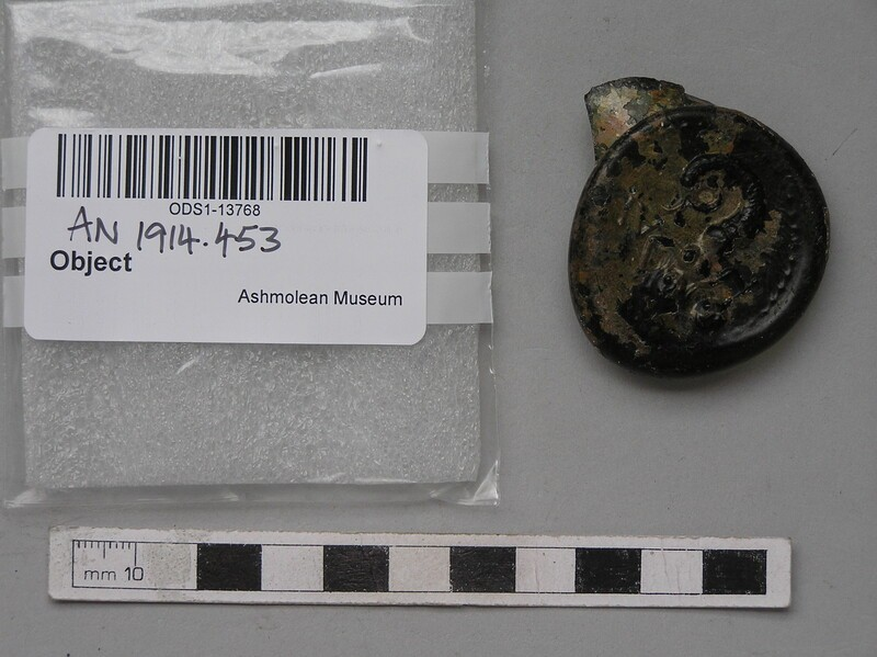Glass bottle seal stamped with mermaid, mirror and comb from Anthony Hall College (AN1914.453, record shot)