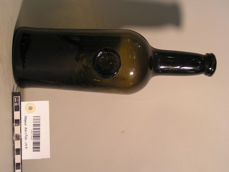 Wine bottle bearing stamp of Jesus College Common room H (AN1910.197, record shot)
