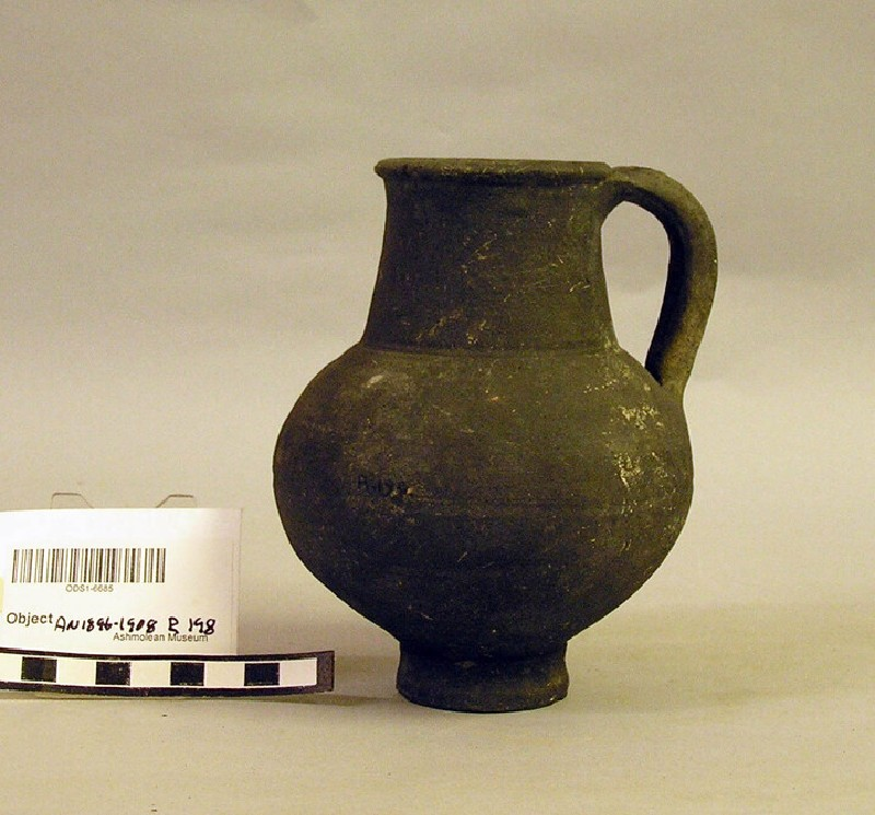 Tall jug of deep black coarse ware with plain handle (AN1896-1908.R.198, record shot)