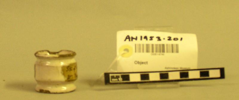 Drug-pot of white ware with pinkish-white tin glaze (AN1953.201, record shot)