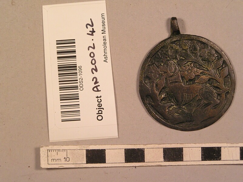Harness pendant embossed with a mastiff dog surrounded by foliage (AN2002.42, record shot)