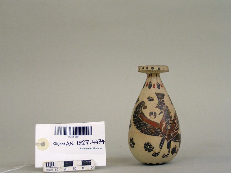Corinthian perfume vessel (alabastron) depicting a male bearded sphinx with polos and lion among rosettes (AN1927.4474, record shot)