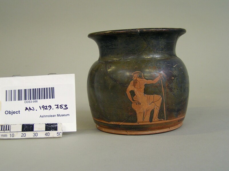 Attic red-figure pottery cup depicting an elderly male figure (AN1929.753, record shot)