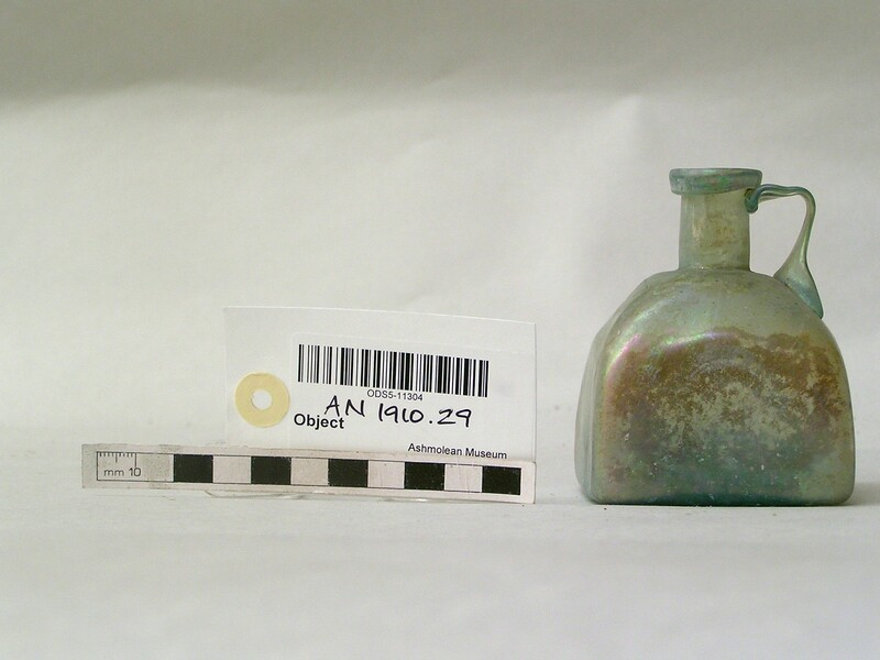 Square glass bottle with a handle