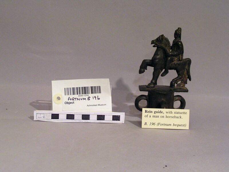 Rein guide in the form of equestrian figure draped wearing a Phrygic cap (ANFortnum.B.196, record shot)