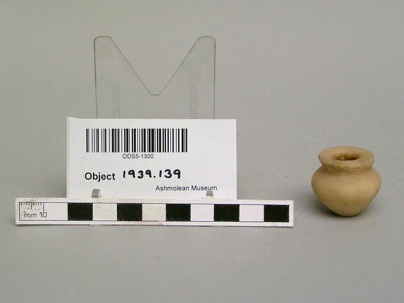 Miniature squat alabaster vase