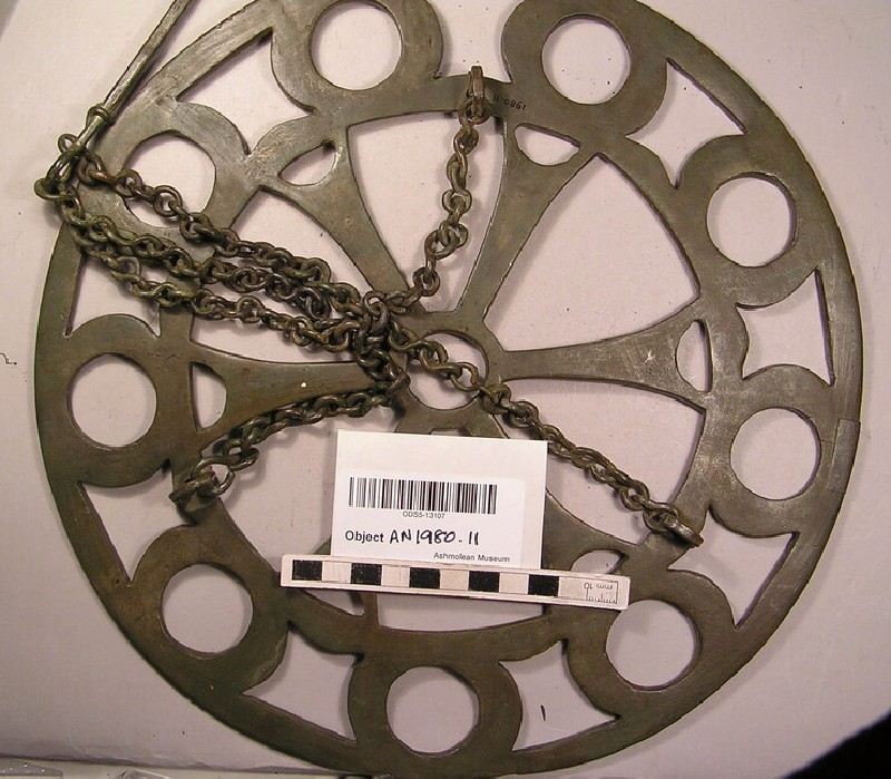 Bronze polycandelon supported by chains and suspension hook