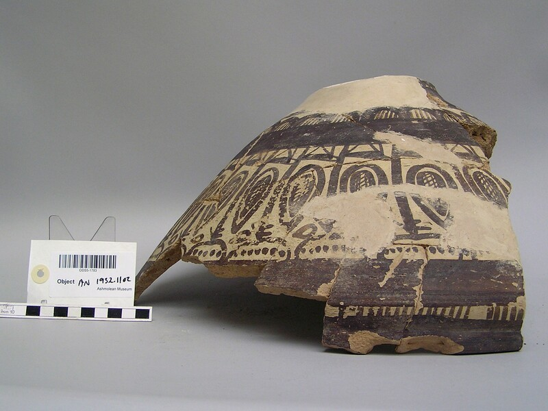 Fragment of a large chalice decorated with frieze of antelope with tall necks and small bodies, solid bands above and below
