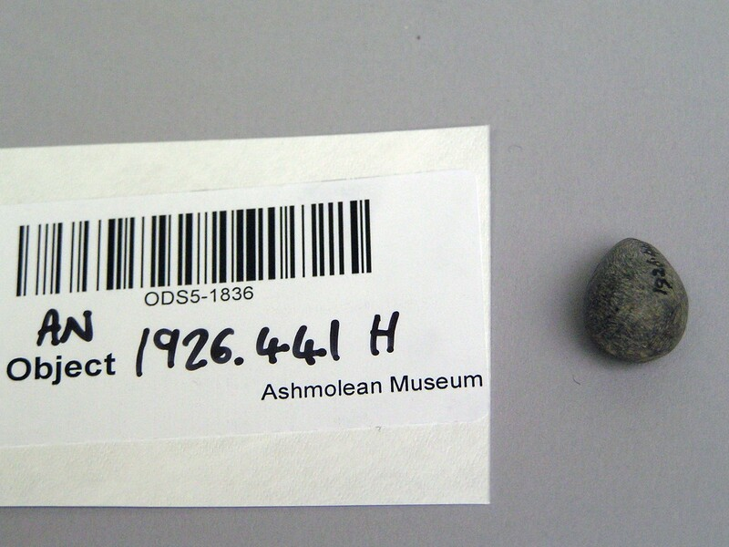Stone gaming piece or token (AN1926.441.H, record shot)
