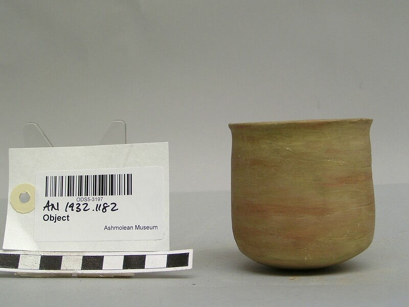 Beaker with traces of red paint