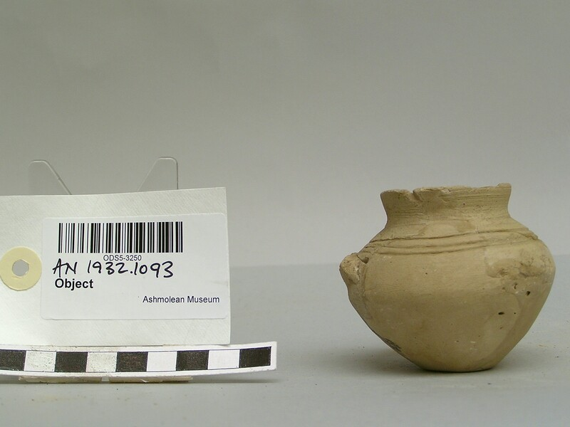 Small pot with incised rings and broken handle