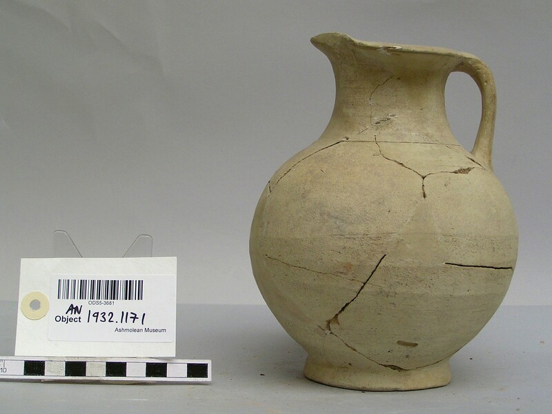 Jug with lip and handle
