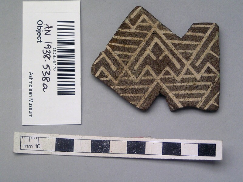 Faience inlay with white geometric designs