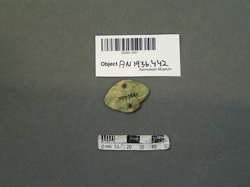 Flat oval or diamond shaped object, perforated twice