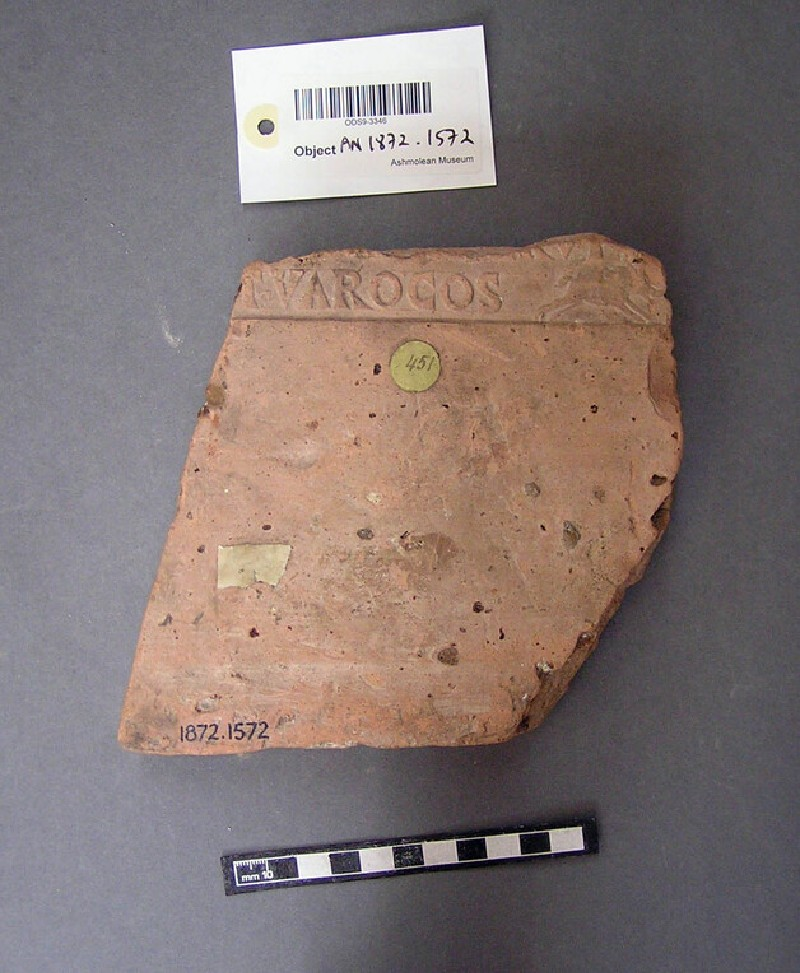 Tile stamped with Latin script, boar running to the right