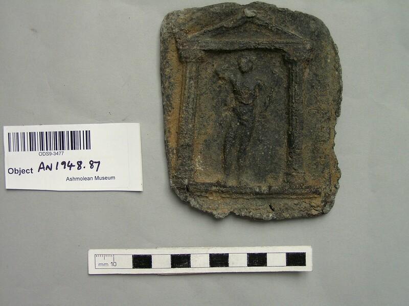 Lead plaque, male figure in relief standing under portico