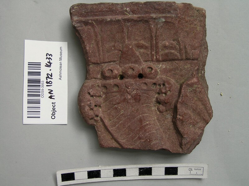 Portion of a frieze of Rosso Antico, part of a figure of a cornucopia