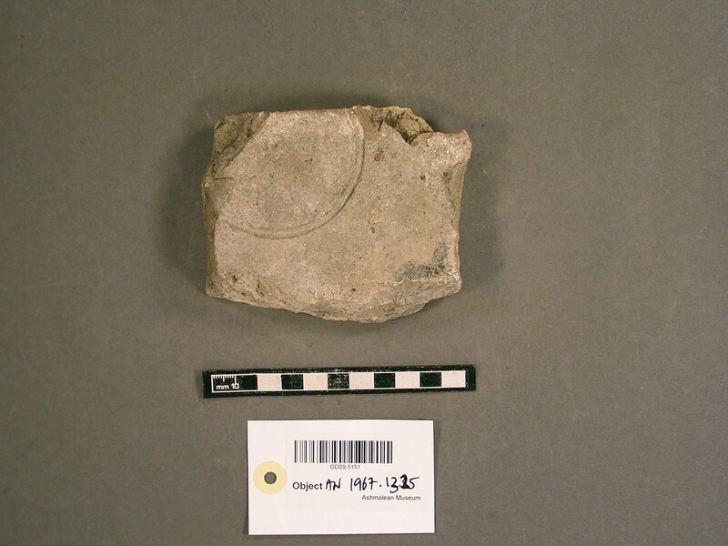 Brick stamped with Latin script, in the center a palm-branch (AN1967.1325, record shot)