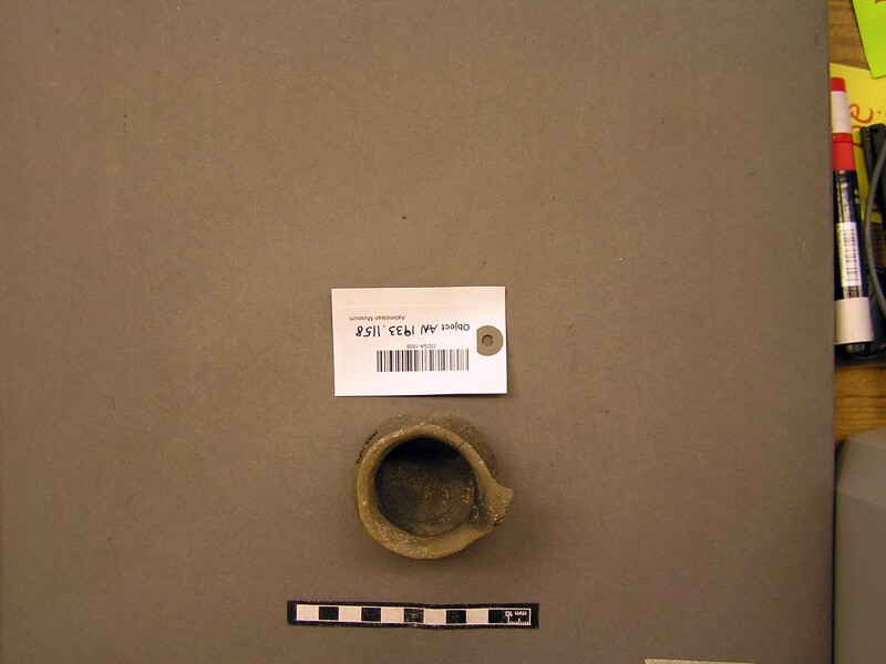 Small squat cup of grey pottery
