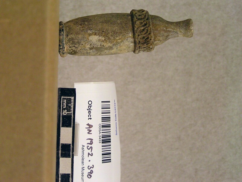 Small straight sided glass bottle with decorated collar (AN1952.390, record shot)