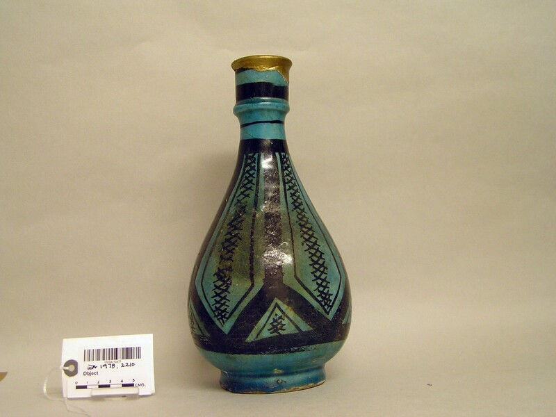 Bottle with panelling and cross-hatched decoration