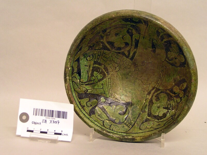 Bowl with winged horse on a background of vegetal scrolls