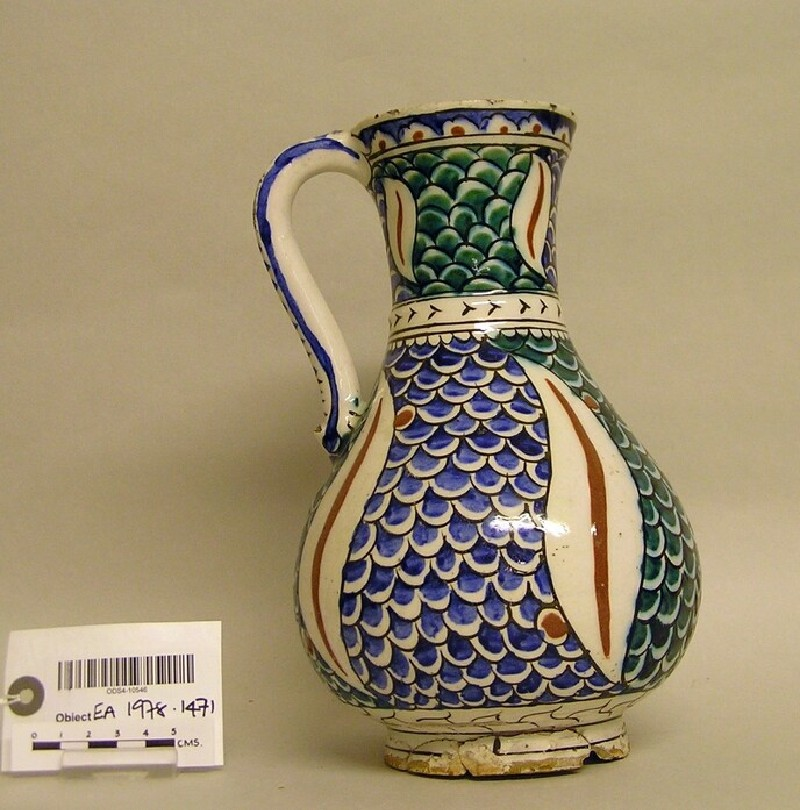 Jug with leaves and fish-scale background