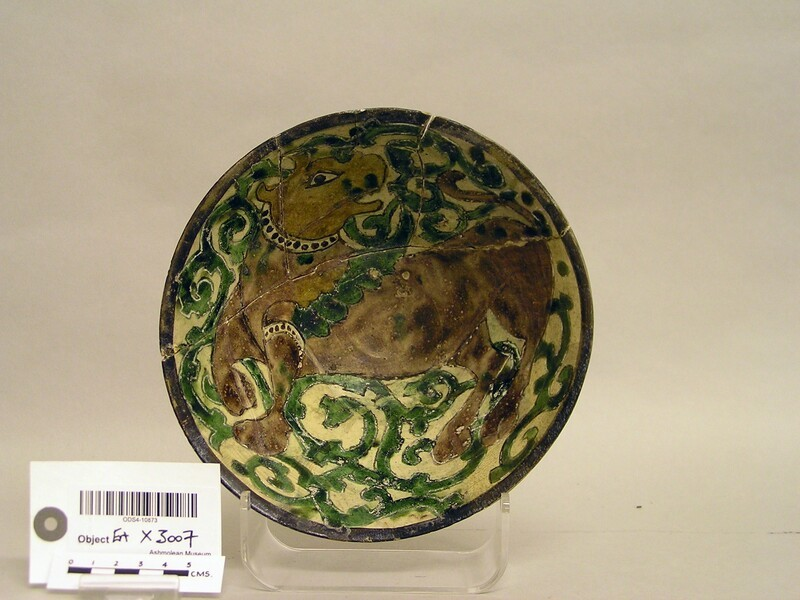 Bowl with bull against vegetal scrolls