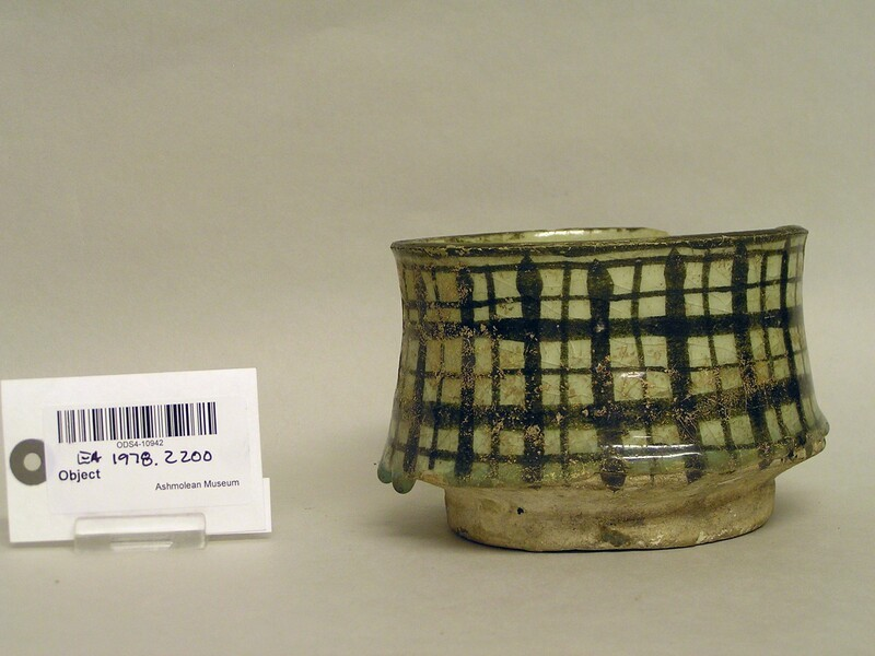Cup with chequered design