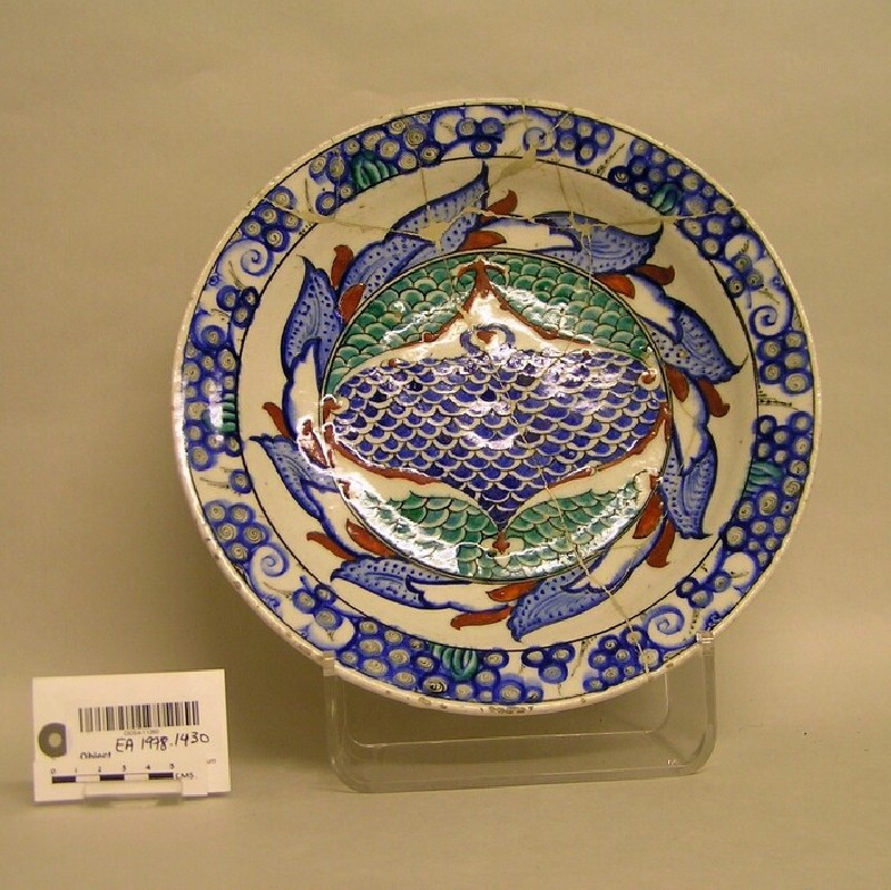 Dish with scaled motifs