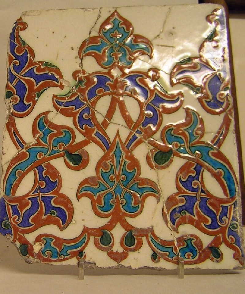 Tile with arabesques