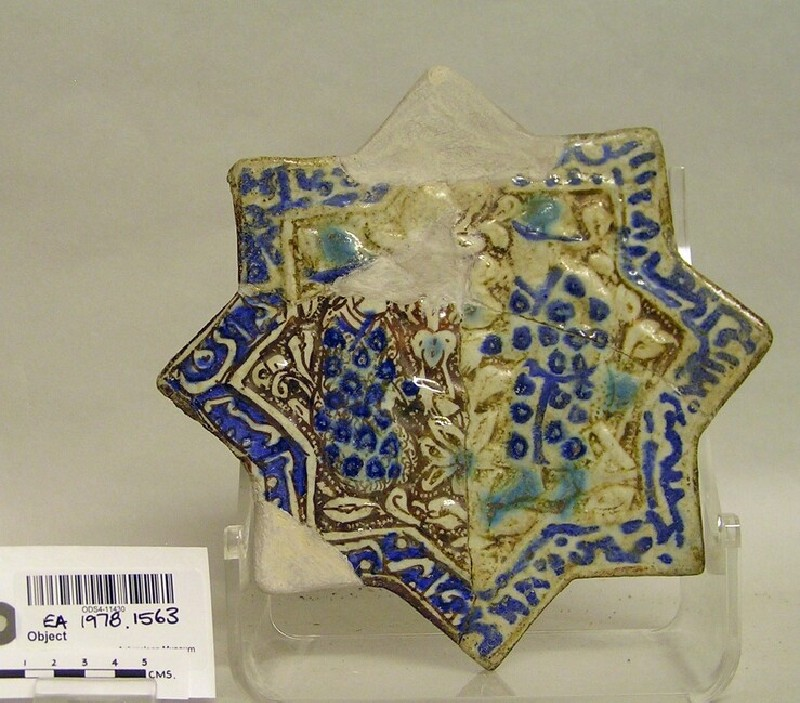 Star-shaped tile with two figures and inscription
