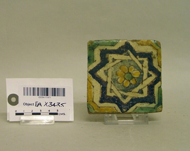 Square tile with geometric and floral decoration