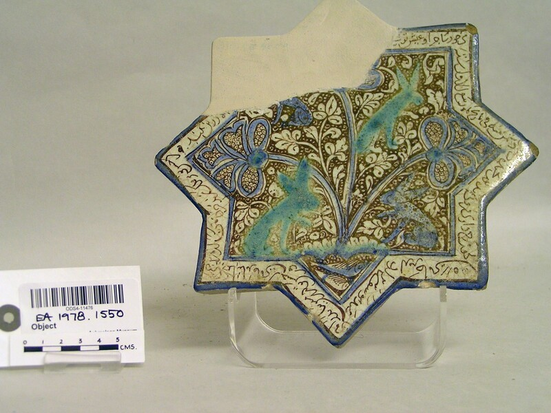 Star-shapes tile with hares and inscription