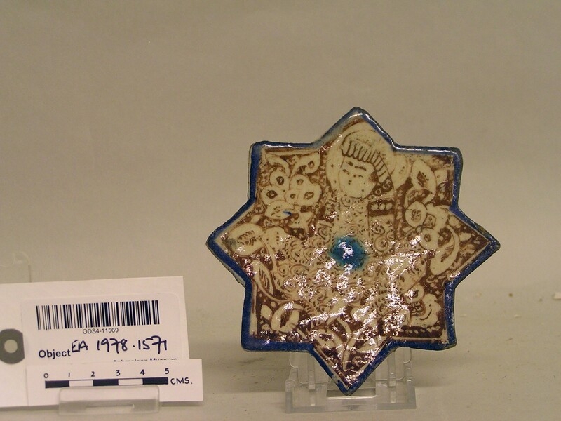 Star-shaped tile with seated turbaned figure (EA1978.1571, record shot)