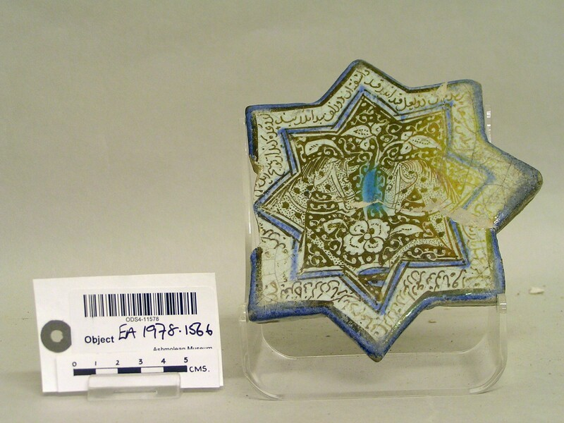 Star-shaped tile with two horse heads and inscription (EA1978.1566, record shot)