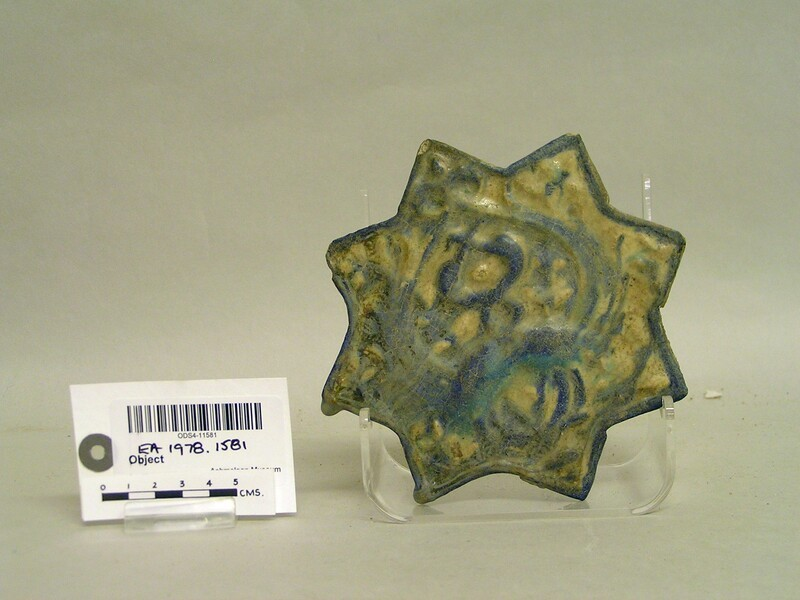 Star-shaped tile with peacocks