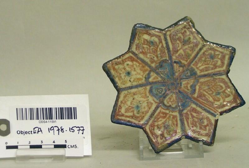 Star-shaped tile with vegetal decoration (EA1978.1577, record shot)