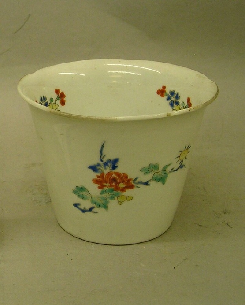 Beaker with blossoms and floral sprays