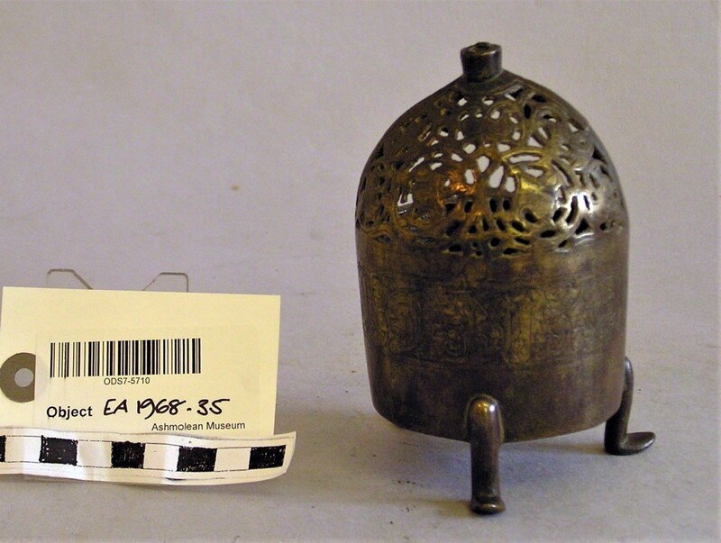 Incense burner with pierced scrolls
