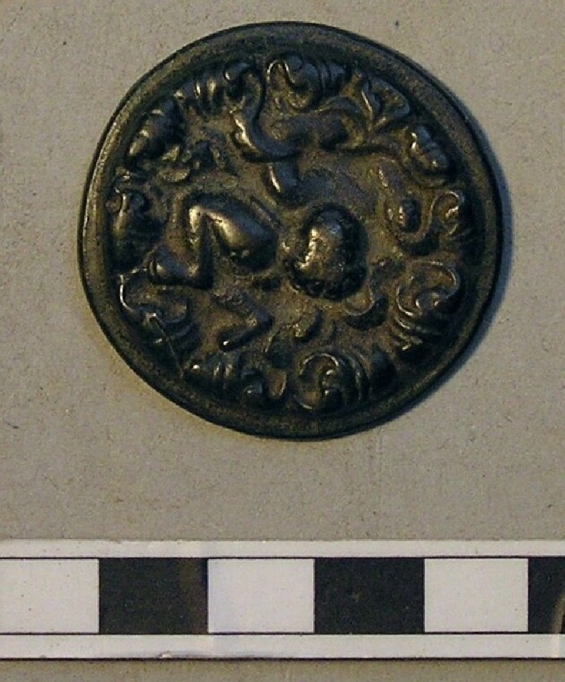 Roundel with flying figure