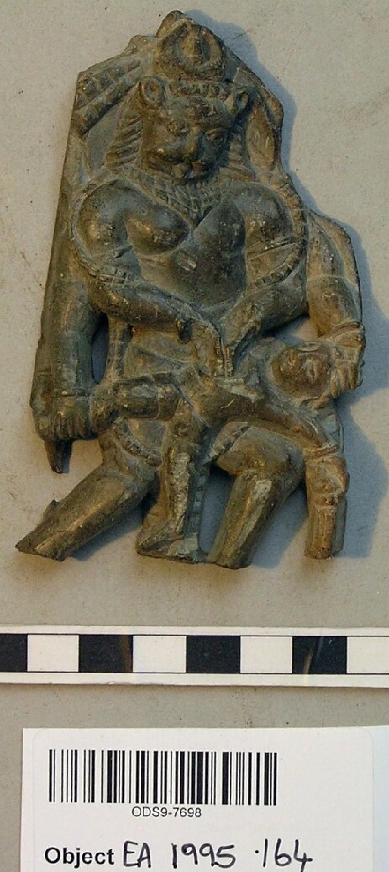 Relief plaque depicting Narasimha slaying Hiranyakasipu (EA1995.164, record shot)
