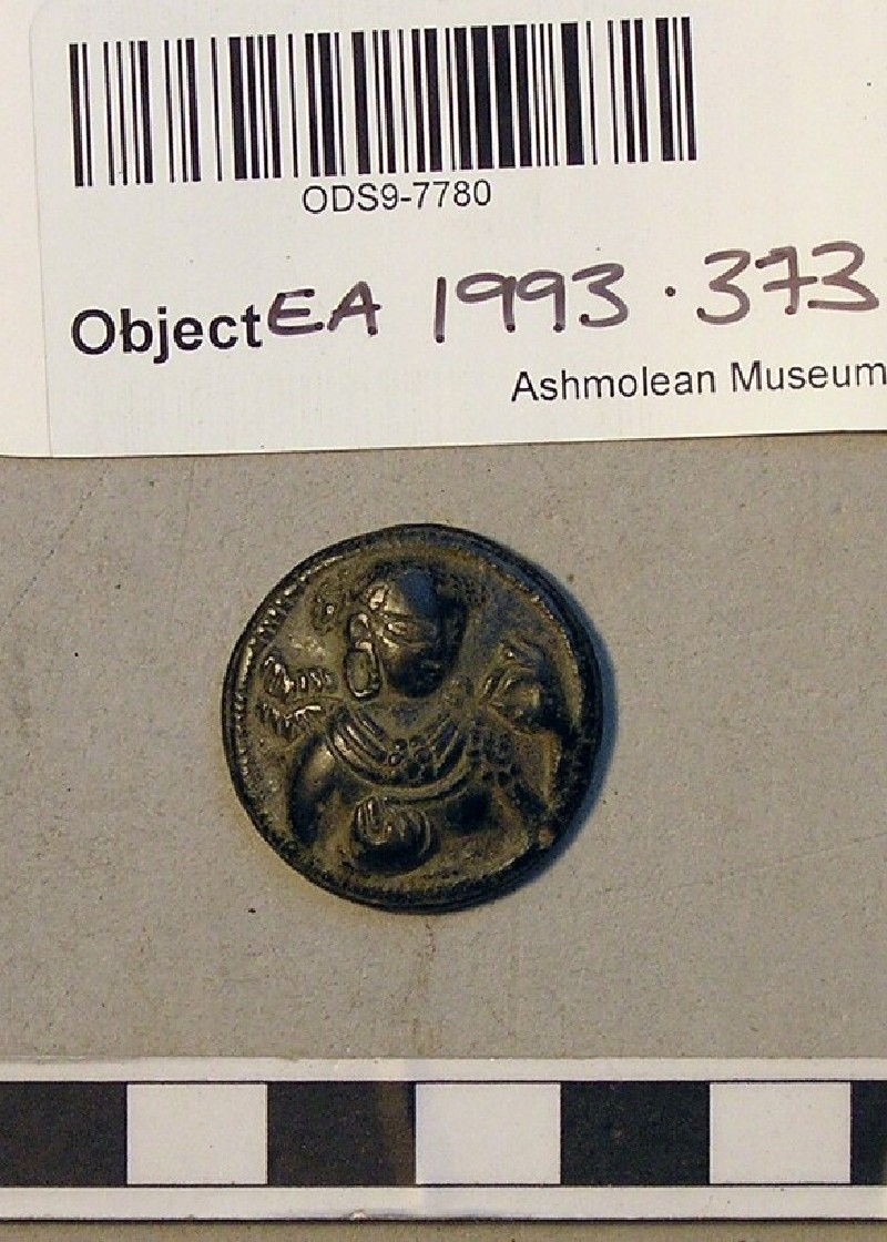Roundel with female figure holding a flower (EA1993.373, record shot)