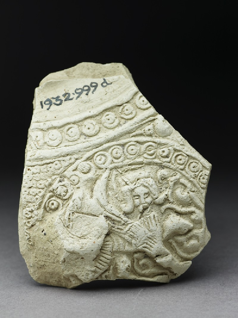 Fragment of a jug with human figure in a roundel (front              )