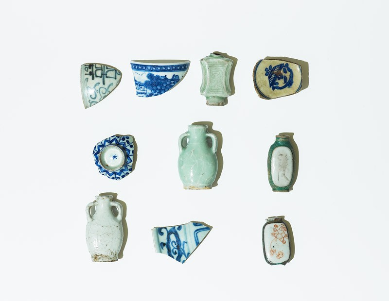 Group of perfume bottles and cup sherds