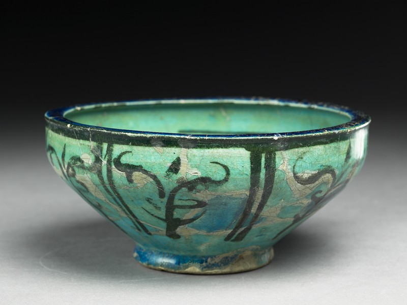 Bowl with seated figure (EA1956.22, oblique, before conservation           )