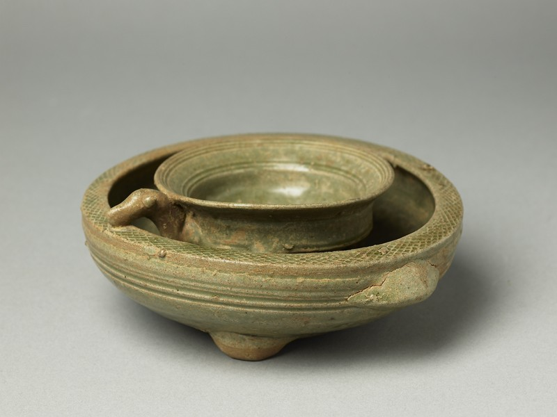 Greenware tripod vessel with inner bowl (EA1956.224, oblique            )